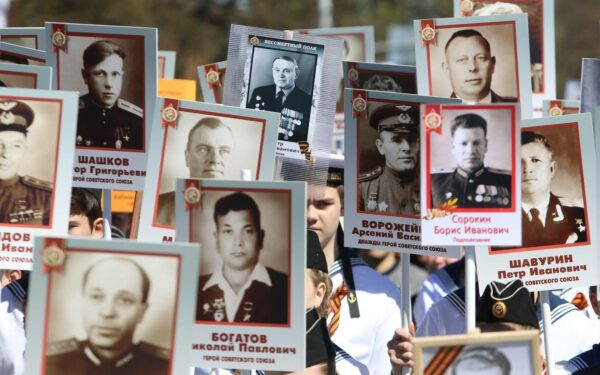People carry portraits of their relatives - soldiers of the Second World War - as they take part in the Immortal Regiment march in downtown Moscow.