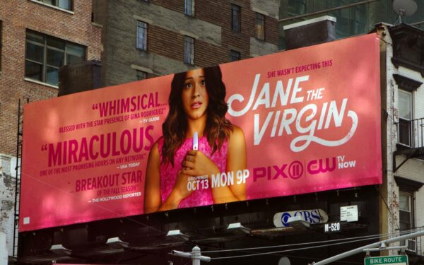 woman on large billboard in the city.