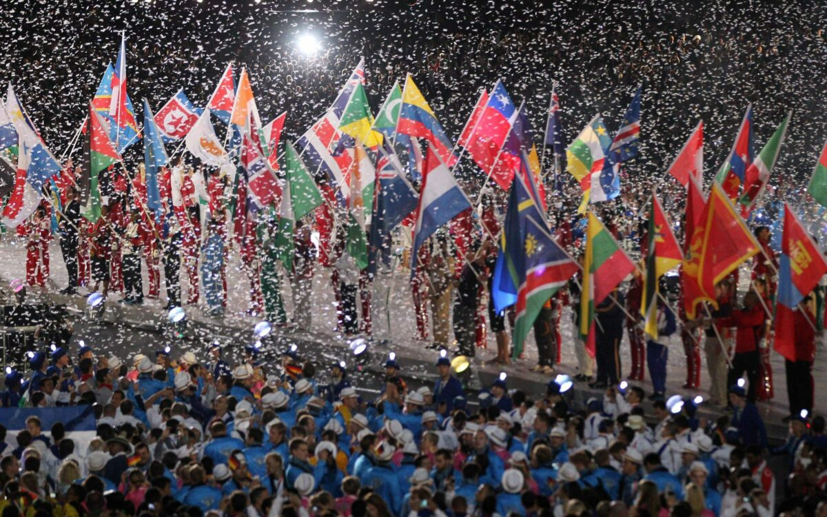 athletes waving flags in a crowd