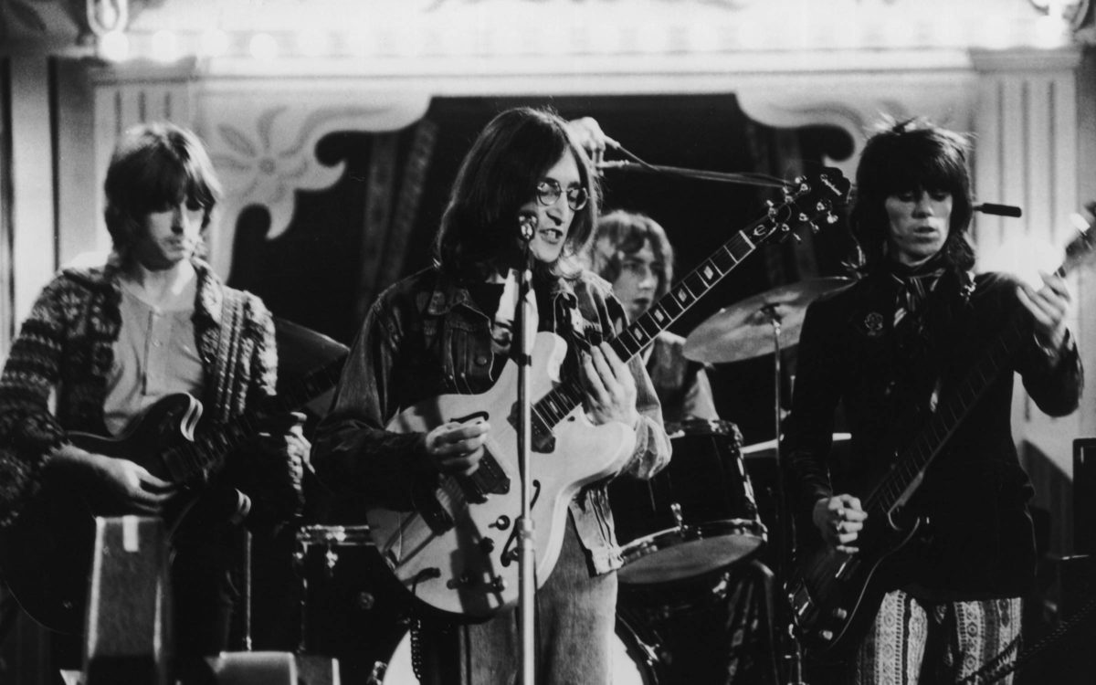 Eric Clapton, John Lennon (1940 - 1980) and Keith Richards performing together at the Rolling Stones Rock And Roll Circus, Internel Studios in Stonebridge Park, Wembley, December 1968.