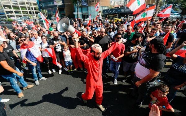 A Lebanese protester chants wearing a mask from Spanish crime show 'The Heist'.