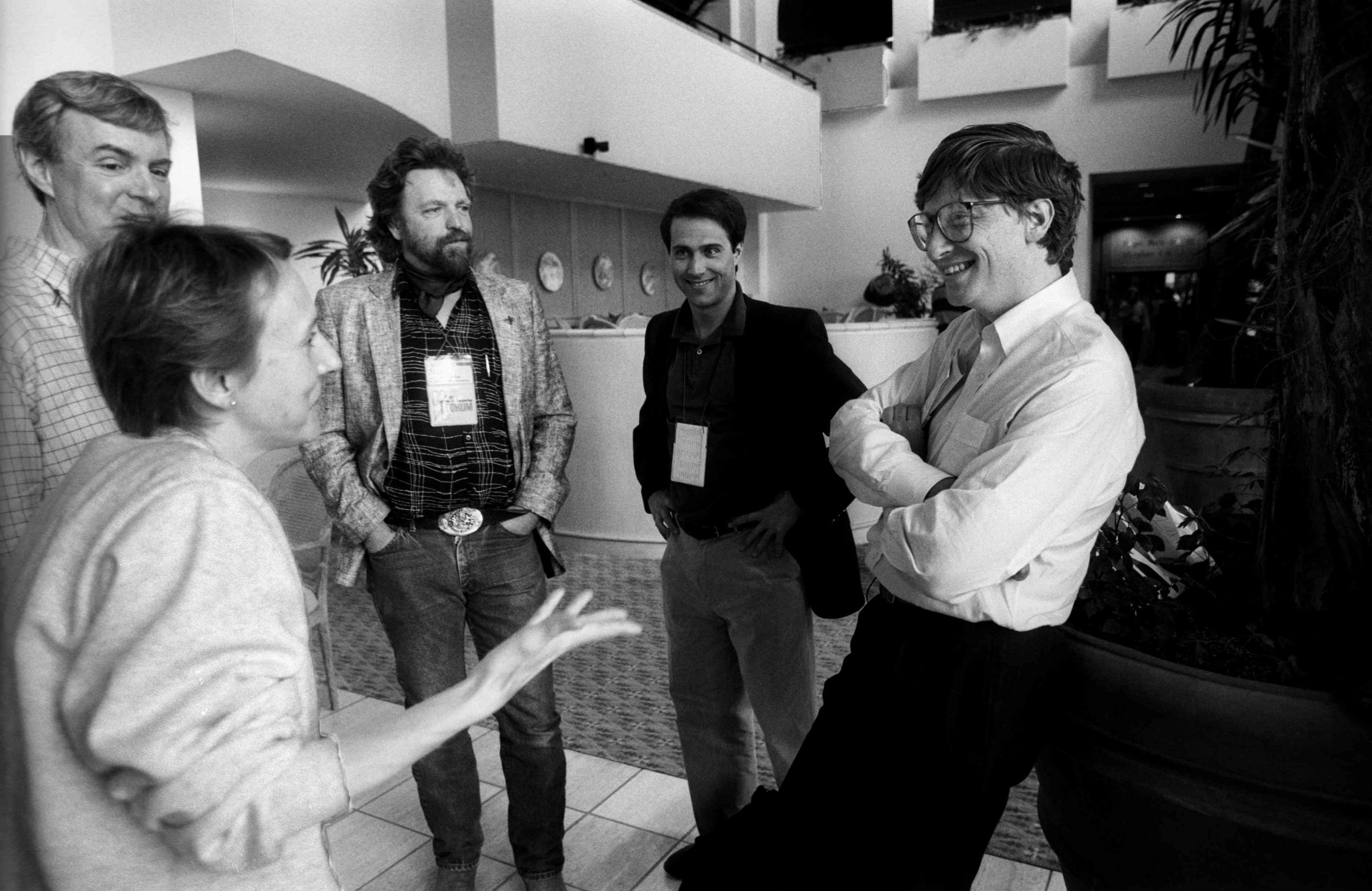 John Perry Barlow (centre, with beard) speaks with Bill Gates at the Annual PC Forum, 1991. Credit: Ann E. Yow-Dyson / Getty Images.