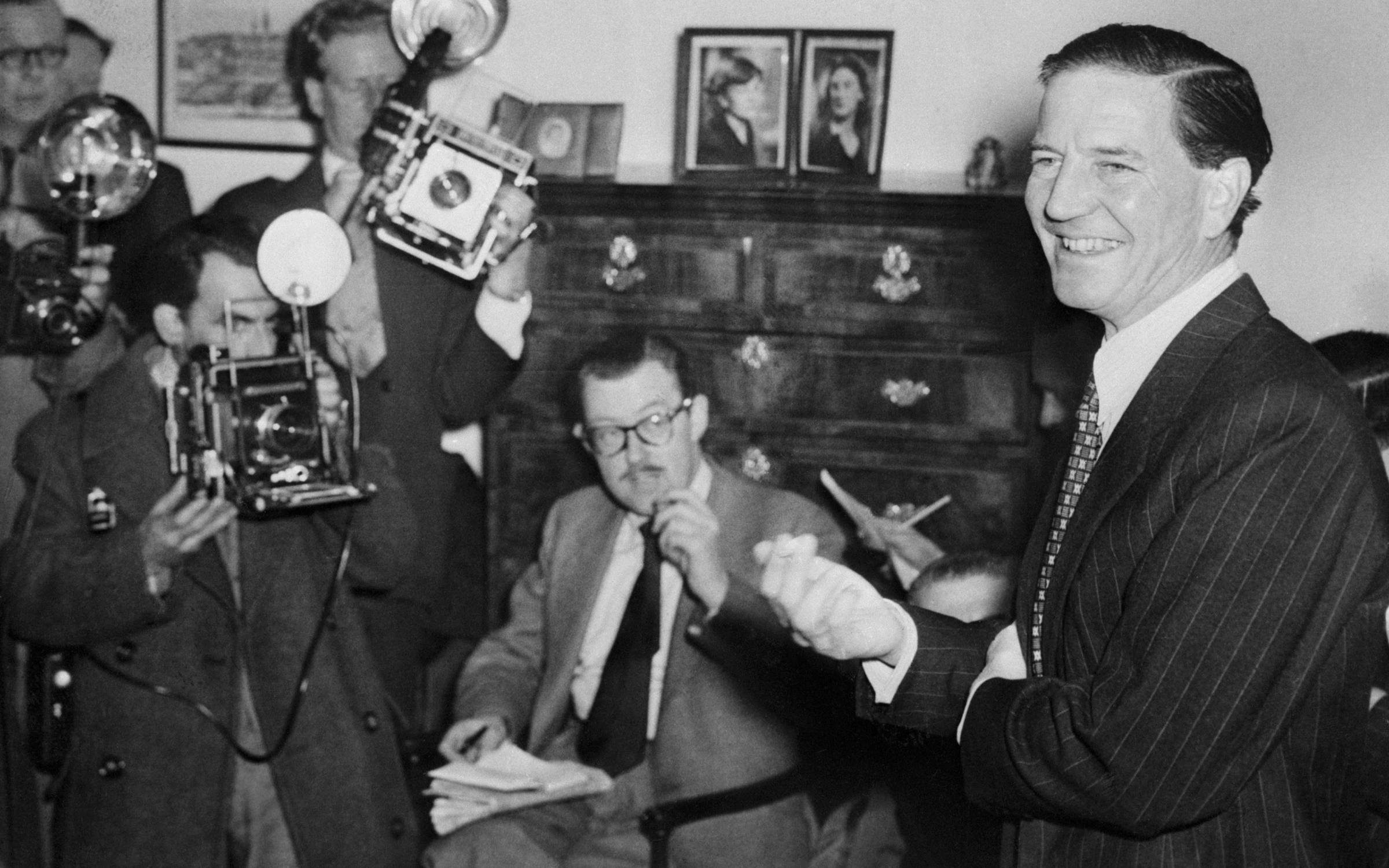 Harold ('Kim') Philby, a former British official in Washington, is shown at a press conference in London, at which he refuted charges of having been the mysterious Third Man in the Burgess-Maclean spy case. Credit: Bettmann