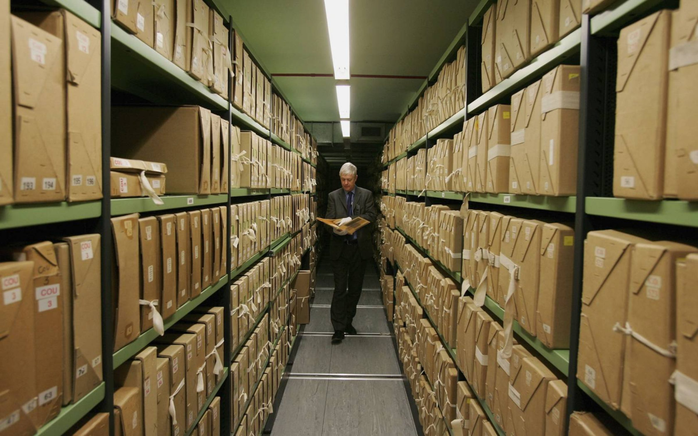 A member of staff removes a file from a depository at The National Archives, London.