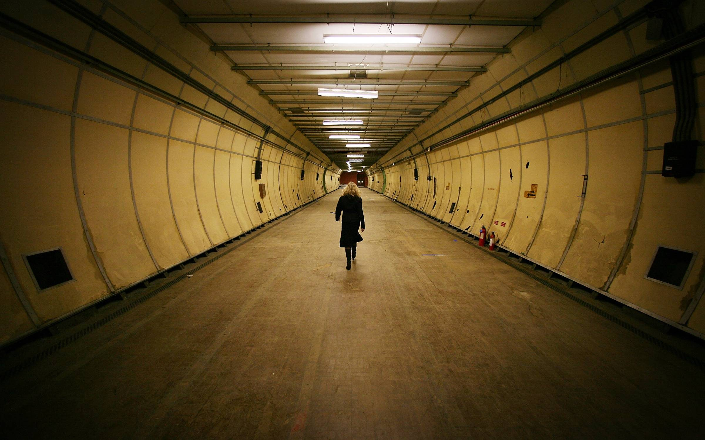 A visitor walks in a formely secret air raid tunnel called Third Avenue in London. The once secret tunnels were built 100 feet under central London in 1940 as fully equipped air raid shelters and could accommodate 8000 people. They have since been used by MI6 and the Public Records Office to hold 400 tonnes of secret documents. Credit: Peter Macdiarmid
