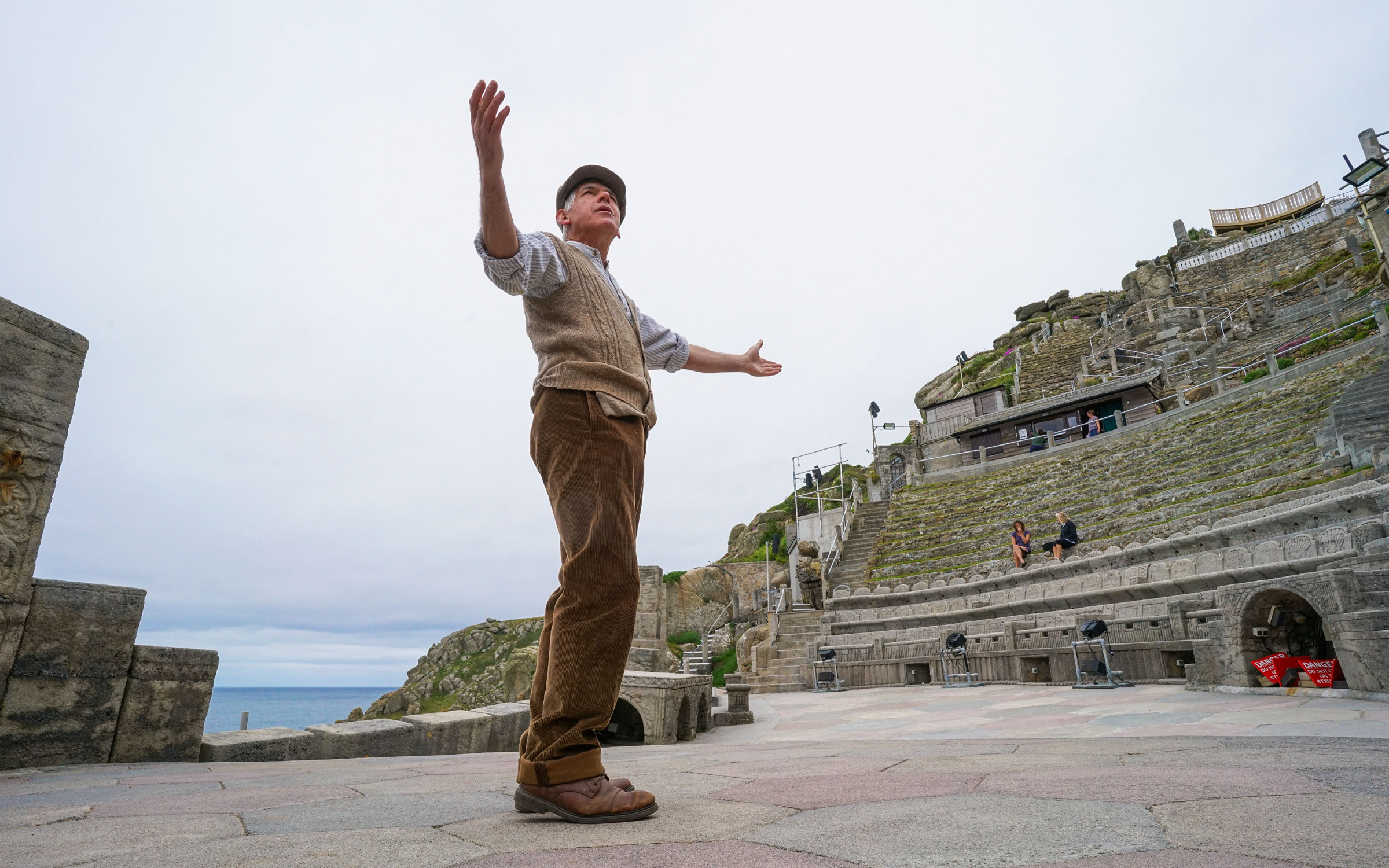 Actor Mark Harandon beckons to a lonely stage at the Minack Theatre, Cornwall, England, this summer. Credit: Hugh R Hastings via Getty Images.