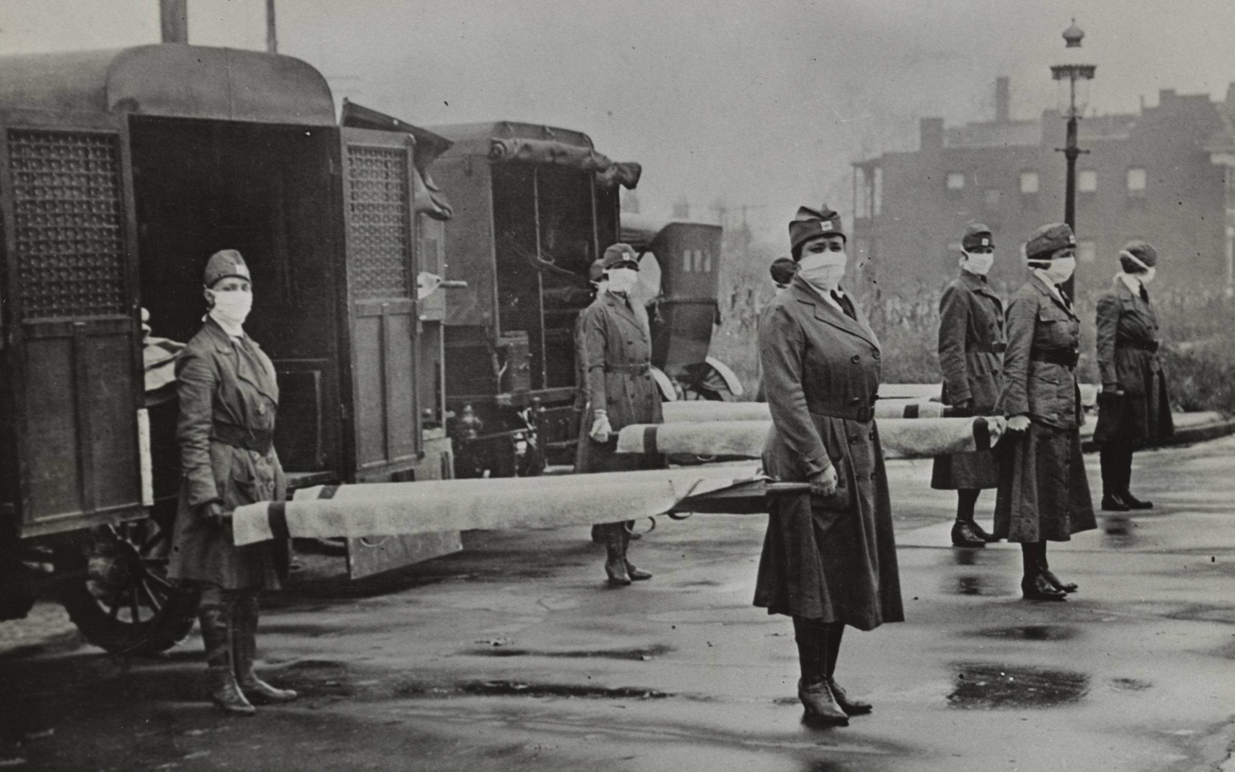 St. Louis Red Cross Motor Corps on duty during the American Influenza epidemic. 1918. Credit: Universal History Archive/Universal Images Group via Getty Images