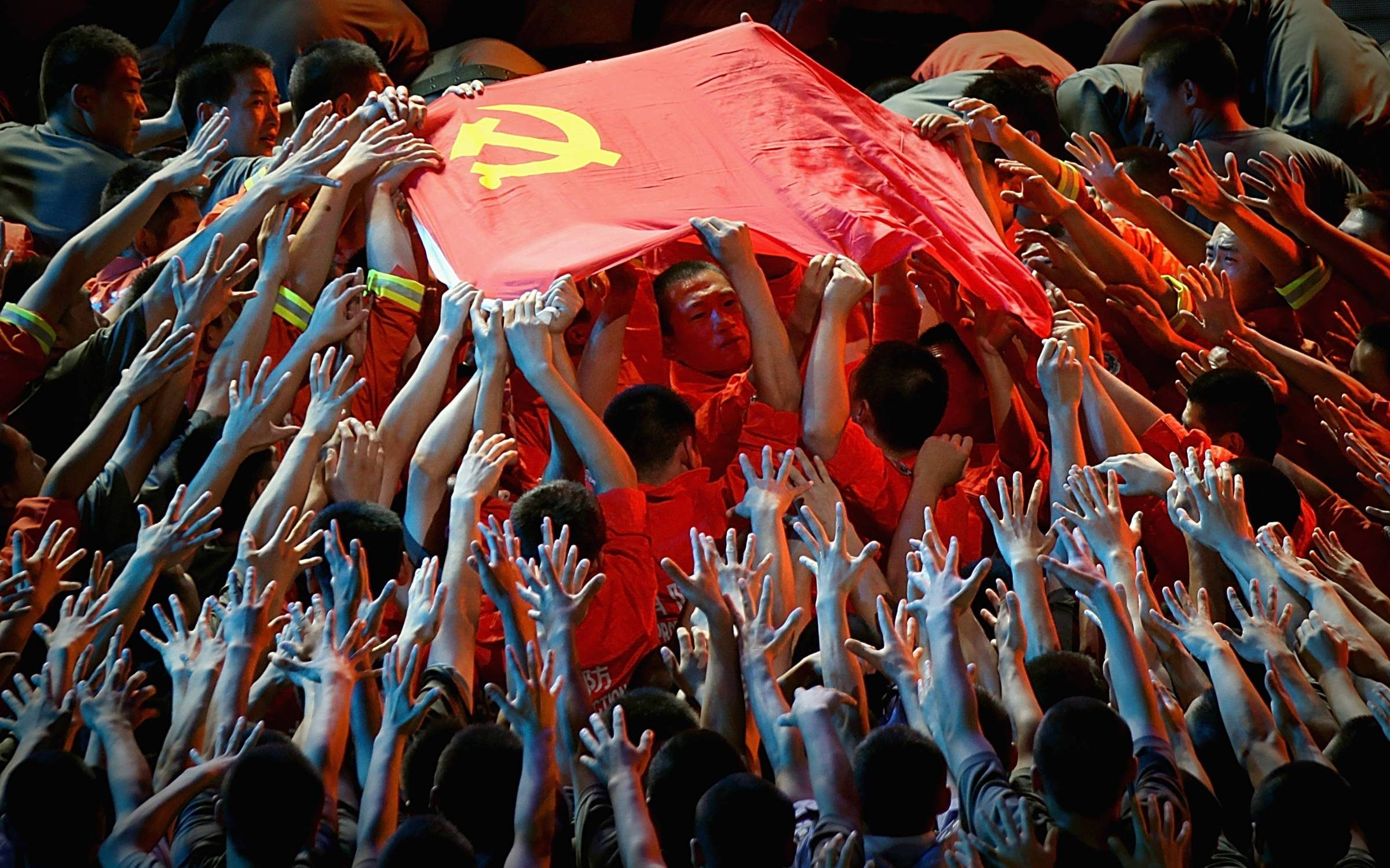 BEIJING, CHINA - JUNE 28: Dancers perform during a gala show to celebrate the 90th anniversary of the founding of the Communist Party of China (CPC) in the Great Hall of the People on June 28, 2011 in Beijing, China. This year's celebrations will mark the 90th anniversary of the founding of the CPC. (Photo by Feng Li/Getty Images)