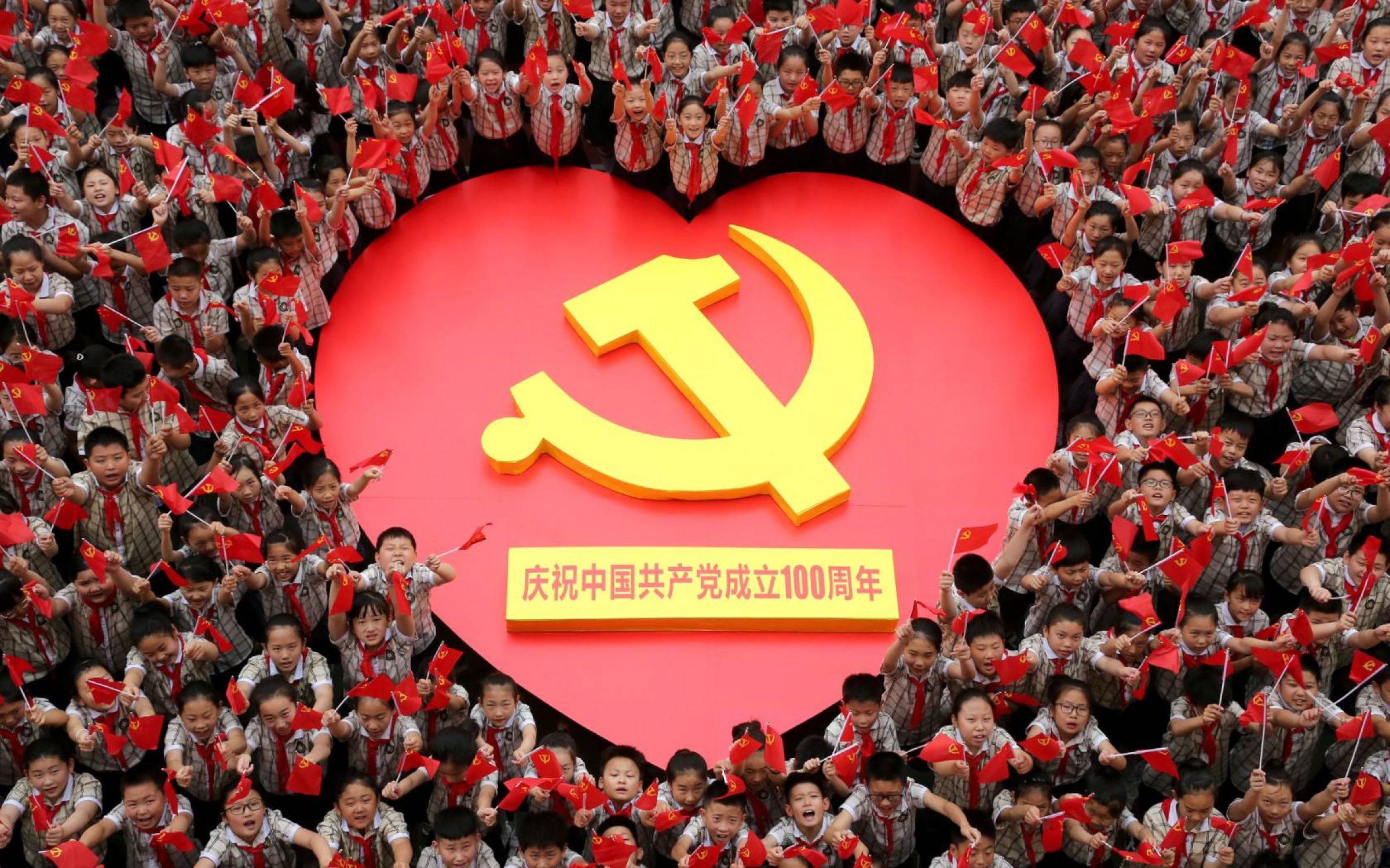Primary school students sing together to celebrate the hundredth anniversary of the founding of the Communist Party of China