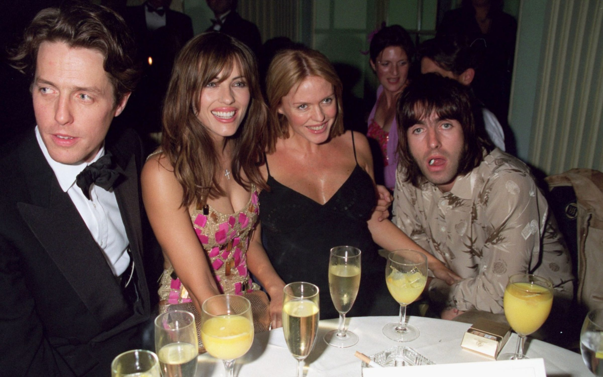 Oasis lead singer Liam Gallagher (right) at the Mickey Blue Eyes premiere afterparty, 1999. Credit: Dave Bennett / Hulton Archive / Getty Images.