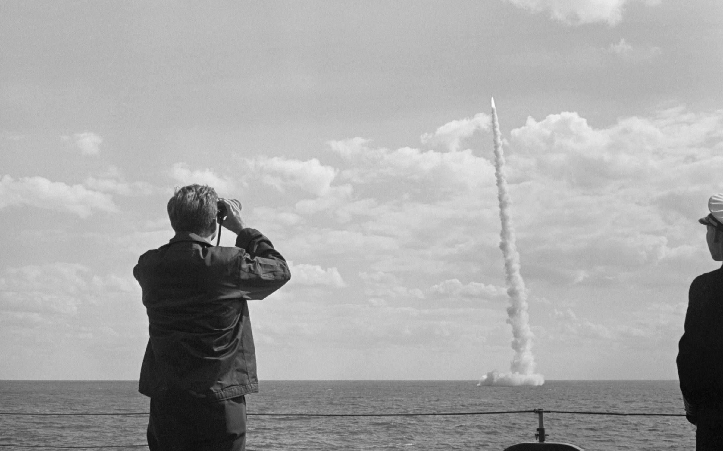 US President John F. Kennedy observing a missile launch of Polaris on board an aircraft carrier. Credit: Getty Images.