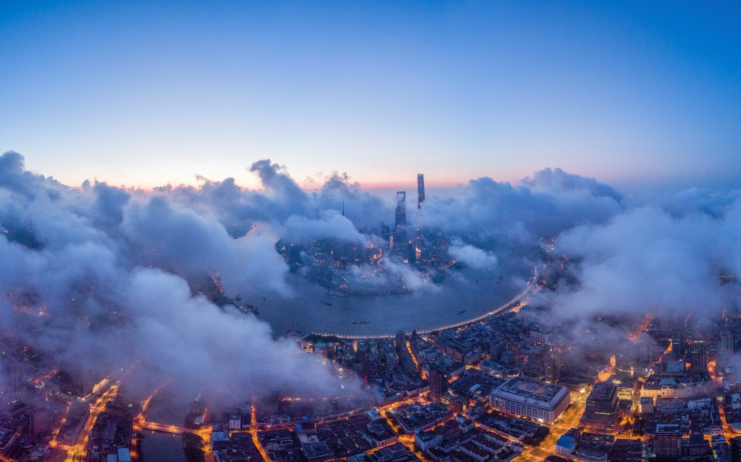 Central Shanghai, China's commercial centre, in low cloud cover. Credit: Xu Feng / VCG via Getty Images.
