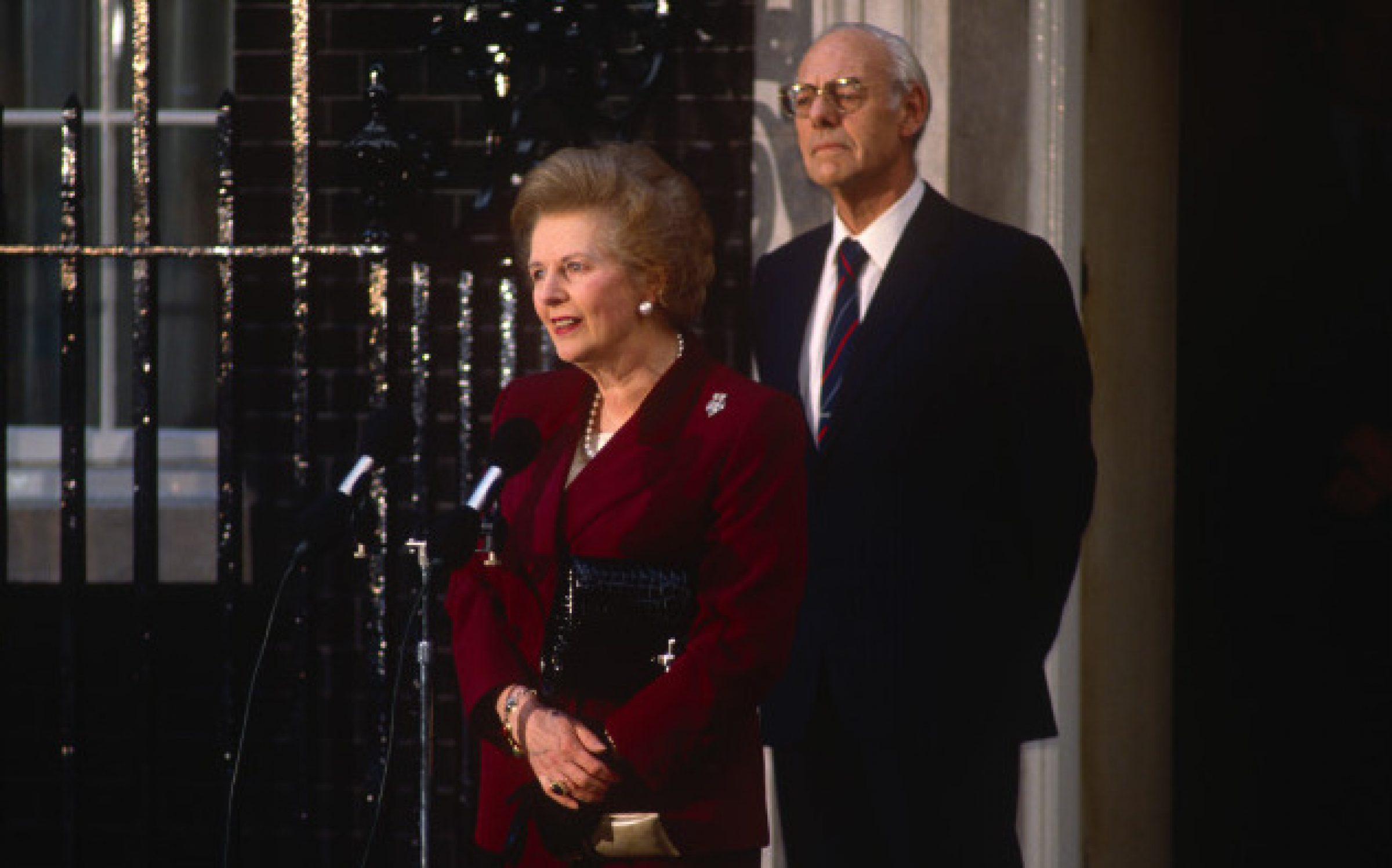 British Prime Minister, Margaret Thatcher's political career of 11 years ends emotionally on the steps of 10 Downing Street after being deposed in a leadership challenge, on 28th November 1990 in London, England. Standing close behind her is Thatcher's husband and lifelong confidente, Dennis. (Photo by Richard Baker / In Pictures via Getty Images)